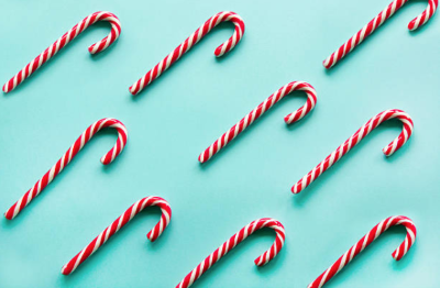 Candy canes in a light blue background